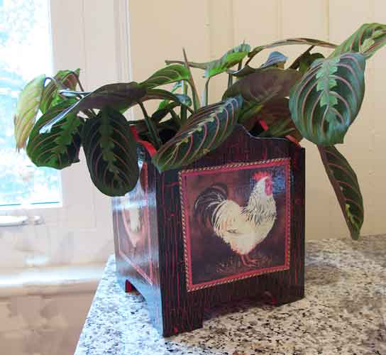 http://www.beachstreetstudios.com/artists/barby-almy/photo-decoupage/4-chickens-planter-decoupage-by-barby-almy/