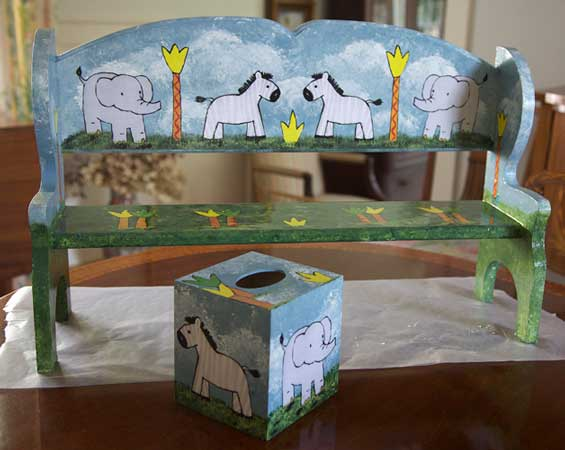 http://www.beachstreetstudios.com/artists/barby-almy/photo-decoupage/bench-and-tissue-box-decoupage-by-barby-almy/